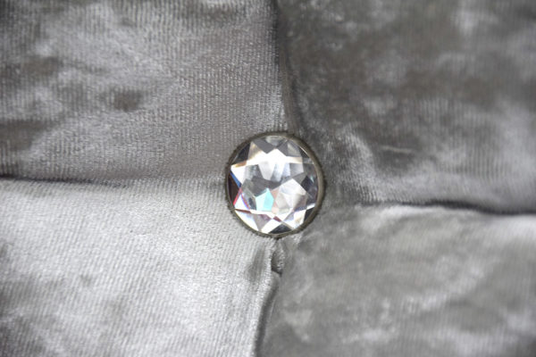 Headboard in silver velvet colour, close up detailed photo showing the crystal effect button