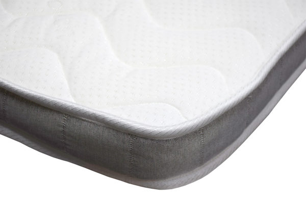 Single size topper mattress, showing the corner