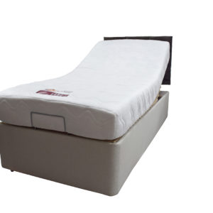 Electric single bed with mattress elevated at the top - angled view