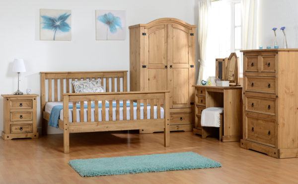 Monaco 5ft King Size bed with high foot end in distressed waxed pine, shown in bedroom