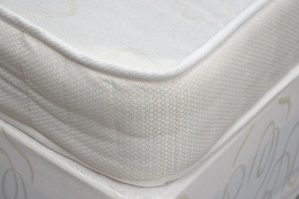 Budget divan bed set includes divan base and mattress, showing the corner