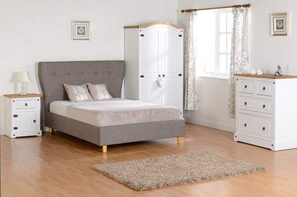 Corona Trio bedroom set in white/distressed waxed pine - 2 door wardrobe, drawer chest and 1 draw 1 door bedside cabinet. Shown in a bedroom setting