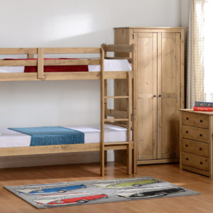 Panama 3ft bunk bed in natural wax, shown in a bedroom