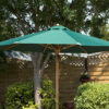 Garden furniture parasol in green, shown open