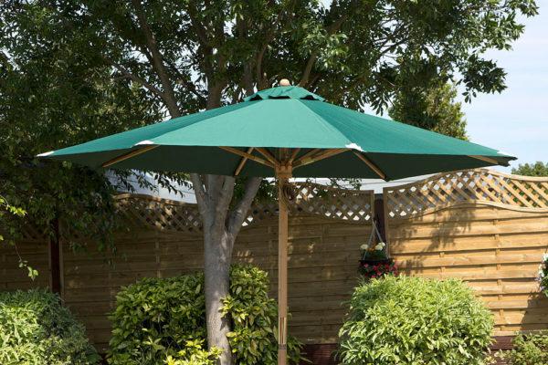 Garden furniture parasol in green, shown open