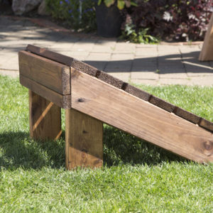 Wooden footstool side view