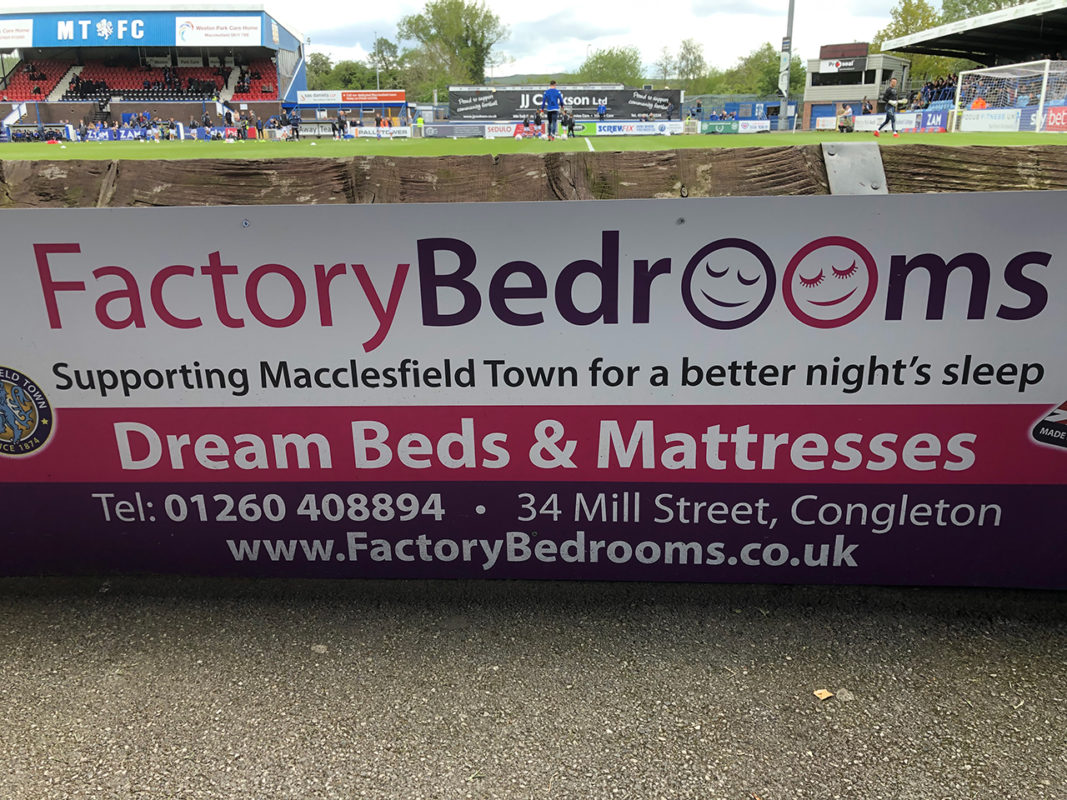 Factory Bedrooms pitch side advert, supporting Macclesfield Town FC for a better night's sleep